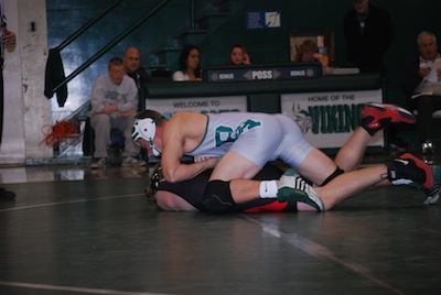 Erik Anderson ('13) pins his opponent in a dual meet last year. Anderson will lead the team as well seasoned captain.