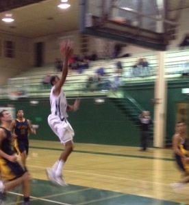 Boys' basketball smashes Milpitas 61-38