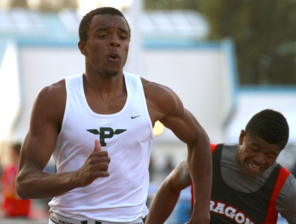 E.J. Floreal ('13) blasts to the finish line of the 100 meter dash completing the race with the first place time of 10.81.