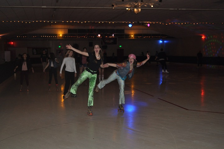 Staff members Pippa Raffel ('14) and Audrey Debruine ('14) pose for the camera. The two along with other staffers tried their hand at Roller Disco at the Redwood Roller Rink.