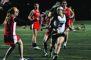 Girls' lacrosse remains undefeated with win over Gunn