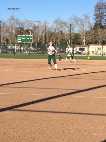 Softball inches by Woodside, 3-2