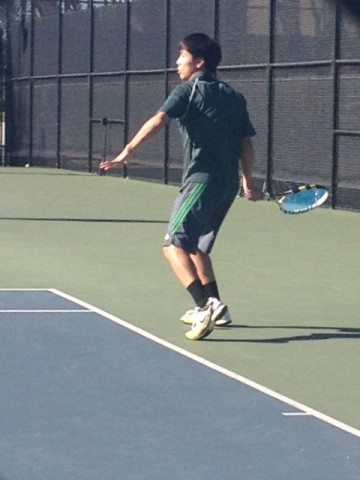 George He ('14) receives a serve during his match.  Paly went on to win 5-2.