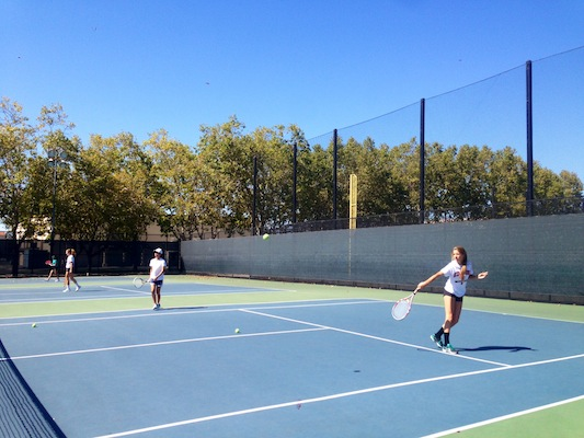 Halle Biorn ('16) anticipates hitting the ball at a recent practice. Biorn is one of the players who is looking to fill the gap of the eight graduated seniors.