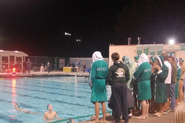The boys' water polo team listens to their coach during a timeout. The Vikings lost to the Salinas Cowboys 10-9.