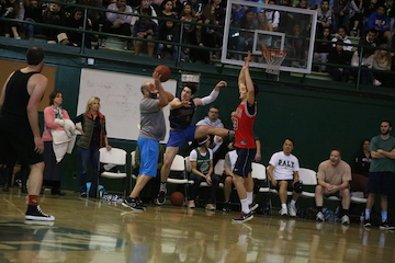 Students triumph over staff in annual basketball game