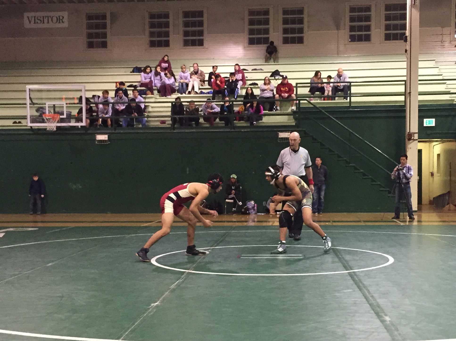 Seth Goyal ('17) looks to take down his opponent in the dual meet against Cupertino on Jan. 22.