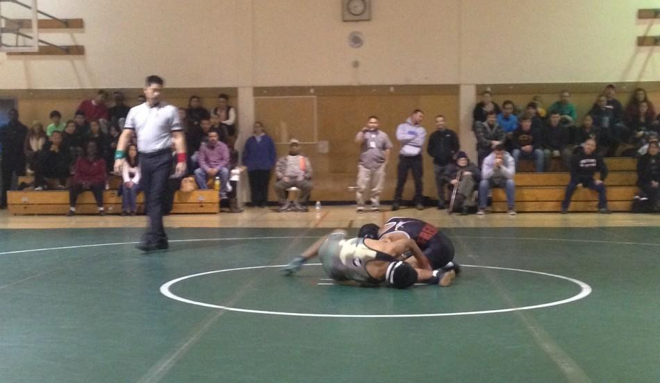 Seth+Goyal+%28%2717%29+wrestles+with+his+Fremont+opponent.+Goyal+went+on+to+win+his+match+16-10.