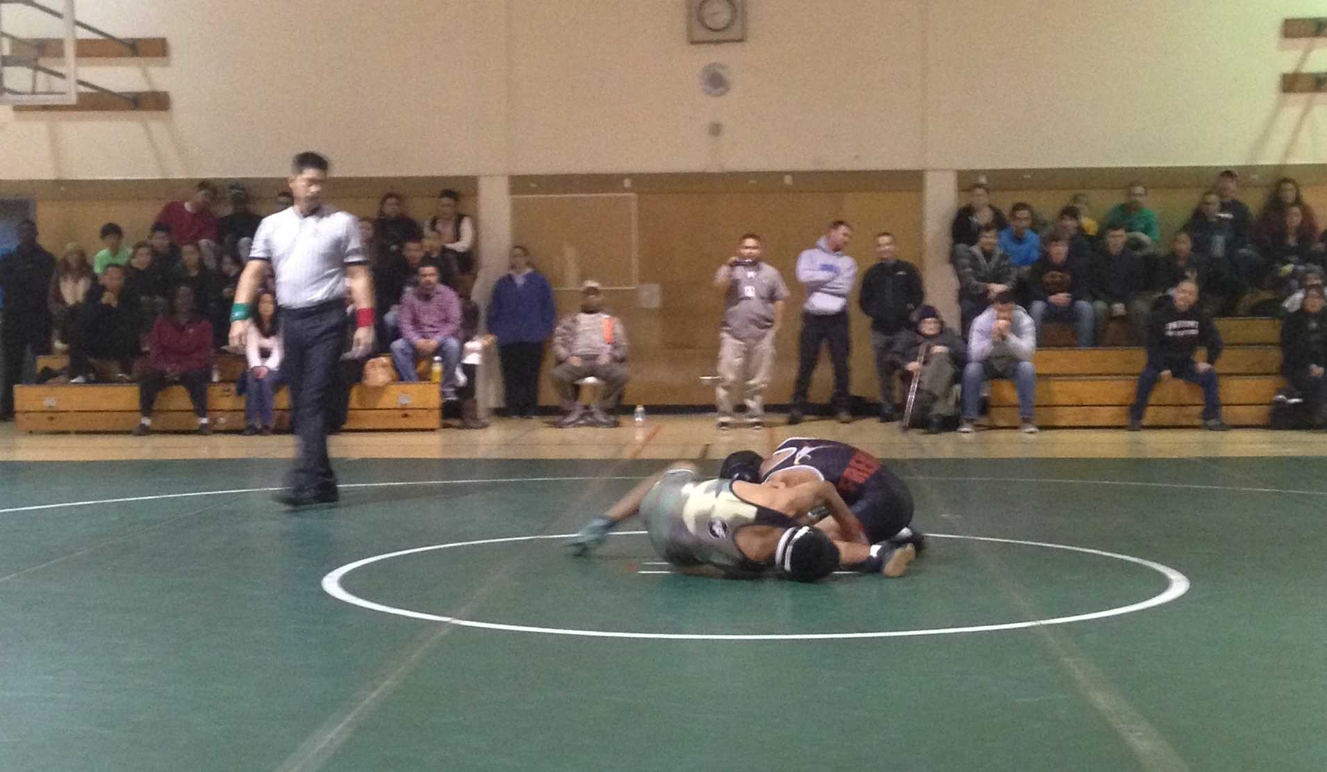 Seth Goyal ('17) wrestles with his Fremont opponent. Goyal went on to win his match 16-10.