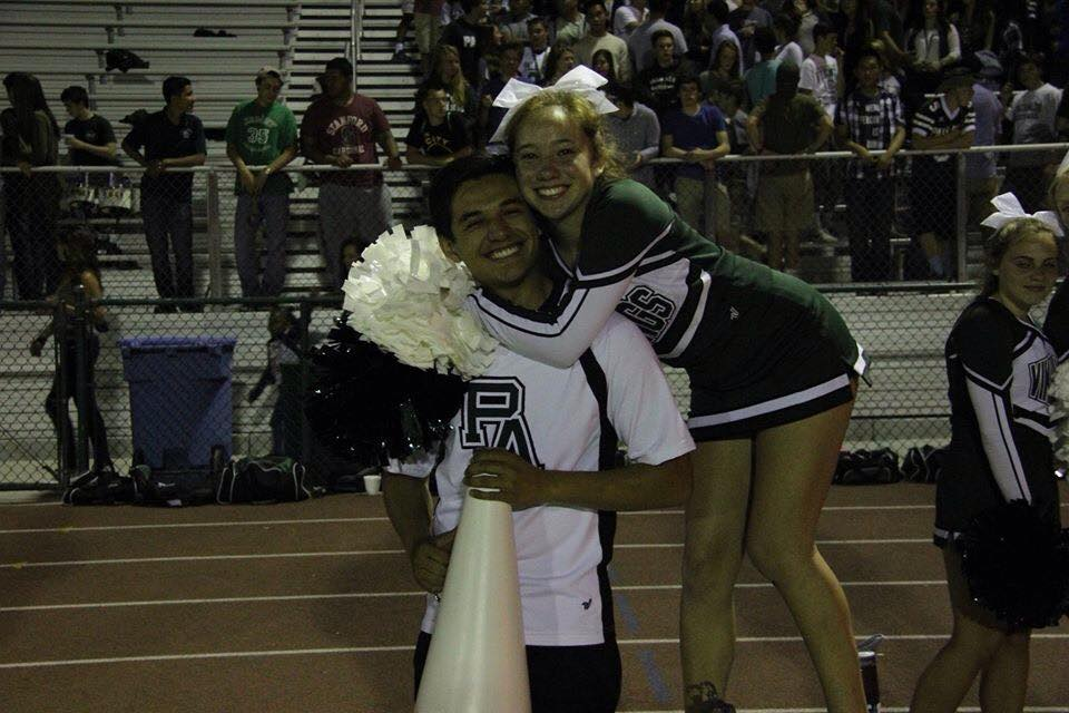 Alfredo Gonzalez ('16) and Ella Higashi ('16) pose on the sideline during one of the Paly football games.