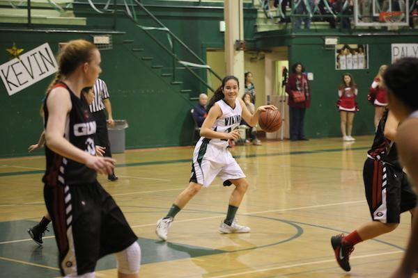 Lauren Koyama ('17) dribbles in last year's game against the Titans.