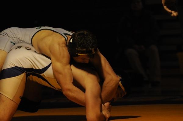 Kalen Gans ('12) goes for a pin against a Monta Vista wrestler.