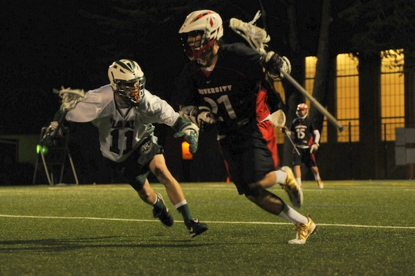Midfield John Brunett ('11) guards University HS in the boys' varsity lacrosse game Tuesday night on the Paly field. Paly won 11-9.
