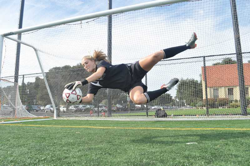 Goalkeeper+Alex+Kershner+%28%2711%29+dives+to+make+a+save+during+warm+up+for+a+league+match.++Kershner+is+going+to+play+for+Duke%27s+soccer+team+next+year.
