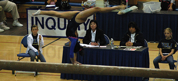 The Cal womens' gymnastics team competes on the beam in a meet against the University of California Los Angeles last season.