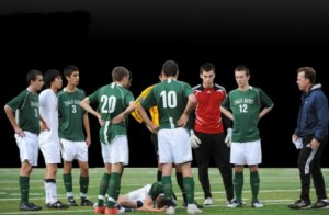 The varsity boys' soccer team gathers around injured teammate John Richardson ('11) after he takes a hit in the Vikings' 1-0 victory against the Gunn Titans on Jan. 12, 2010.
