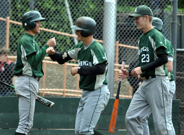 Pederson('10) celebrates with teammates after hitting one out.