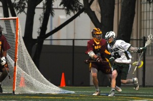 Jonny Glazier (13') challenges from behind in the match-up against Menlo Atherton.
