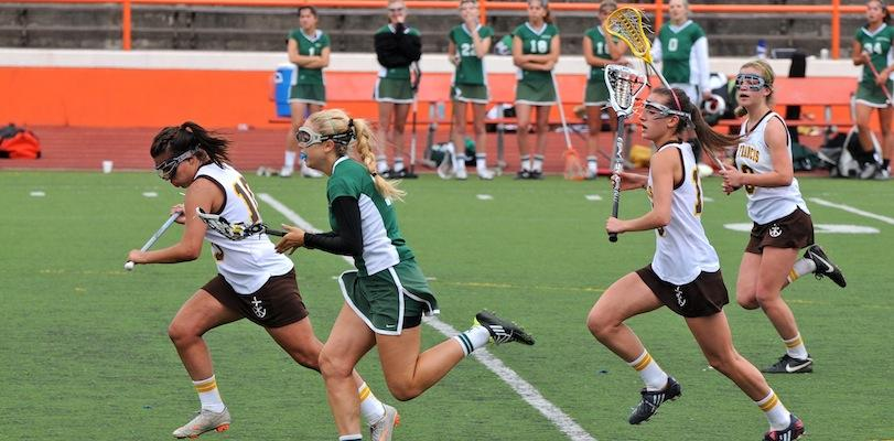 Kimmie Flather ('12) runs the ball down the field in an attempt to spark a Paly comeback. The Lady Vikes fell to the Lancers 13-8.