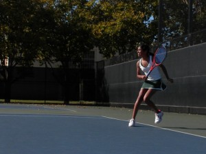 Budhiraja runs for a return in the first set. As the No. 1 single, she plays in every meet. Photo by Hilda Huang