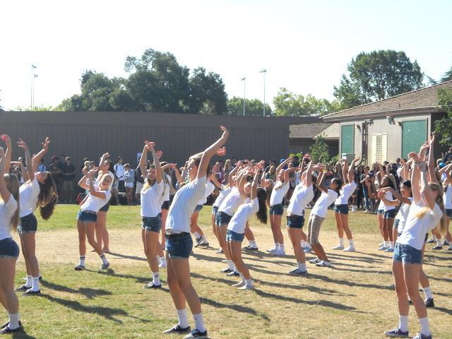 Bump, set, dance? Girls' volleyball teams perform flash mob