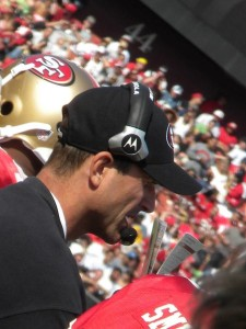 Paly graduate, Jim Harbaugh talks with quarterback Alex Smith before sending him on the field.