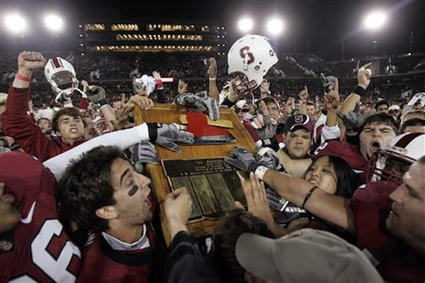 The Stanford Cardinal celebrate a victory over Cal in the annual