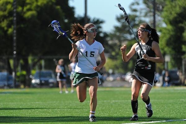 Emy Kelty (12) drives down the field in a game against Gunn High School.