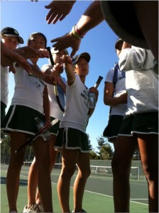 The girls put their hands in for their prematch P-A-L-O-A-L-T-O cheer at a Oct. 20 game against Los Altos.