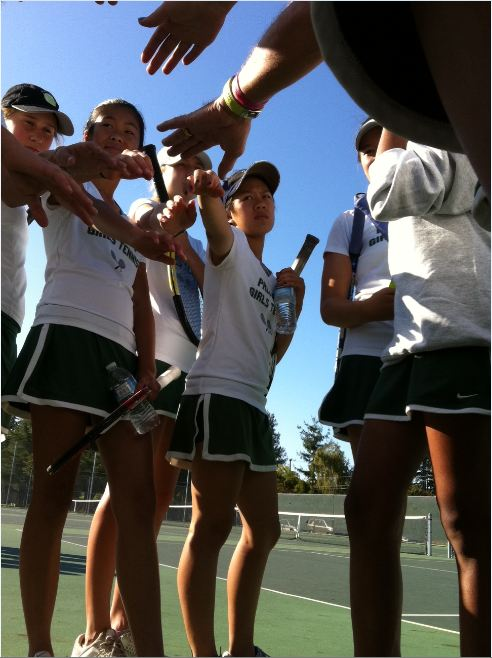 The+girls+put+their+hands+in+for+their+prematch+P-A-L-O-A-L-T-O+cheer+at+a+Oct.+20+game+against+Los+Altos.+
