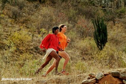 Scott Jurek runs with a Tarahumara Raramuri. These Raramuri, or runners, have been credited for pioneering the sport of ultramarathoning.