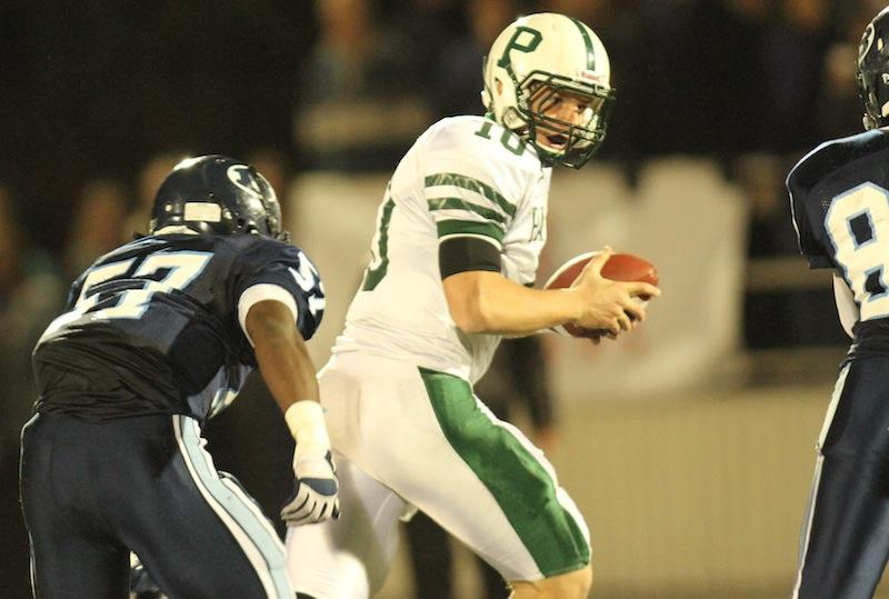 Keller Chryst ('14) scrambles away from the pressure of the Bellarmine defense