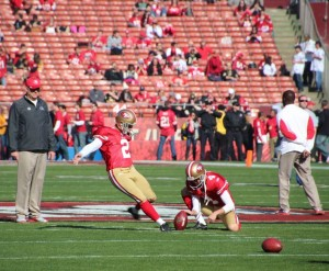 David Akers takes some practice field goals to warm up for todays game. Akers scored 12 points for the niners in today's game.