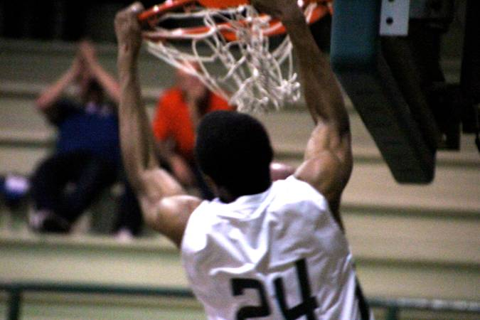 E.J. Floreal (13) dunks on a fast break in Friday nights loss to Cupertino High School. Floreal had 11 points for the Vikings.