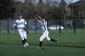 Paly third baseman Alec Wong ('12) goes in for the catch on the Paly baseball field. He joined the varsity baseball team his sophomore year, and has also played varsity basketball for three years.