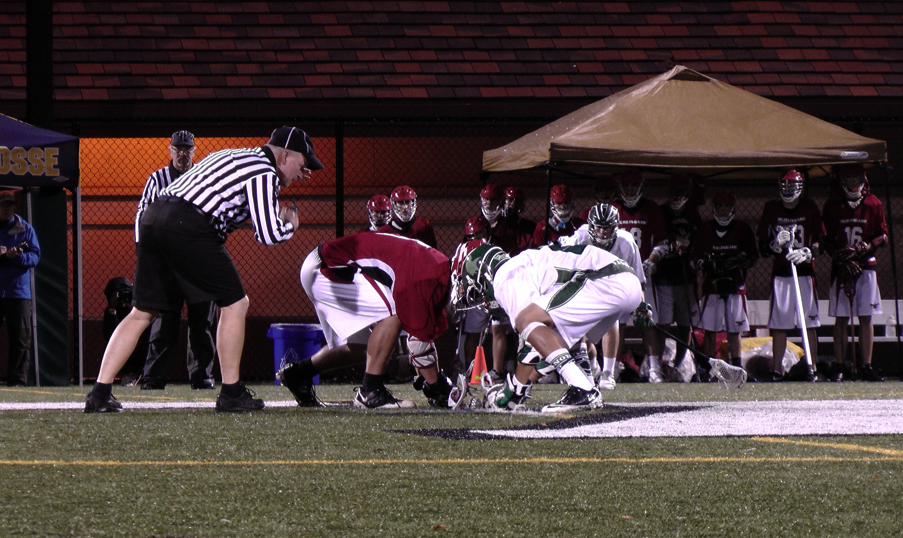 Matt Lam ('12) faces off against Burlingame. Lam had two goals against the Panthers.
