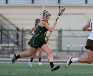 Kimmie Flather ('12) drives up the field. Photo by Grant Shorin