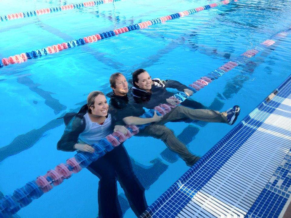 Head coach Danny Dye (Center) and assistant coaches Angela Duckworth and Lucy McComas take a celebratory dip in the Lynbrook pool after learning of their teams' wins. Coach Dye is hoping to have both the girls' and boys' teams end up first at the CCS championships too.