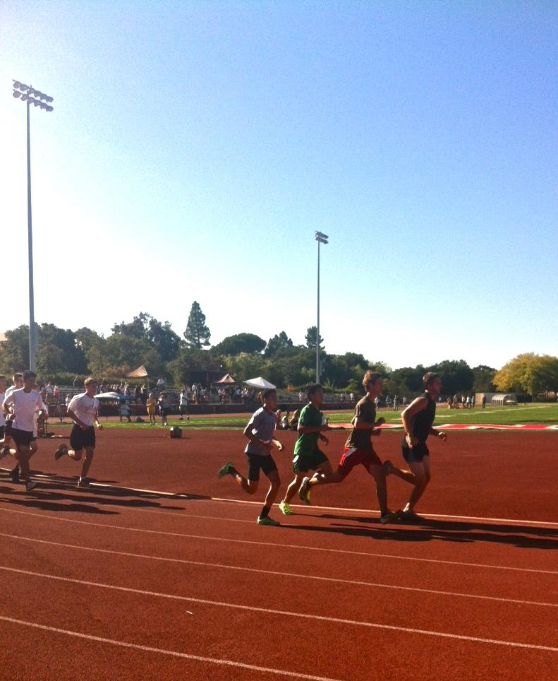 Seniors+Marco+Vienna%2C+Ben+Hawthorne%2C+and+Justin+Zhang+run+the+first+400+meters+of+the+race.++Hawthorne+took+first+place+for+the+team.