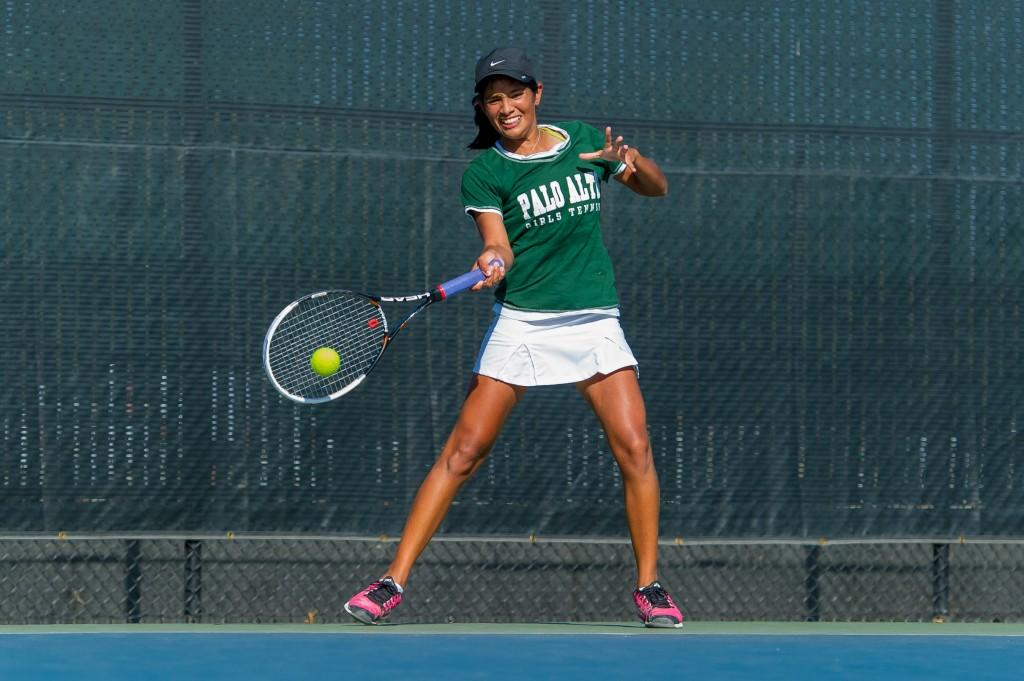 Co-captain Aashli Budhiraja (14) returns a forehand at last weeks Paly Invitational. Today, Budhiraja was the only player to win (6-4, 6-1) her no. 1 singles match against Los Altoss Kacey Incerpi.