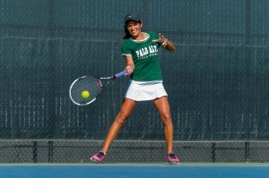 Co-captain Aashli Budhiraja ('14) returns a forehand at last week's Paly Invitational. Today, Budhiraja was the only player to win (6-4, 6-1) her no. 1 singles match against Los Altos's Kacey Incerpi.