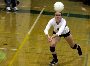 Shelby Knowles ('13) digs for the ball in the second set of the game.