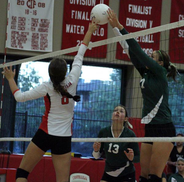 Bella Graves ('14) fights to tip the ball over the net in the second set.