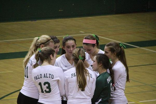 The Lady Vikes huddle up before their first league game against Gunn.