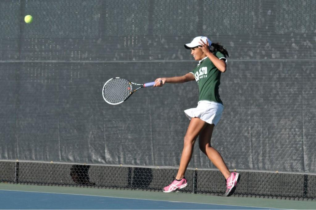 Aashli Budhiraja (14) walks in a powerful forehand shot that sailed deep along the right side of the court, winning her the third game in her second set against Leland. Budhiraja, now ranked 48th in California for high-school girls tennis, will play as No. 1 single against Saratoga today.