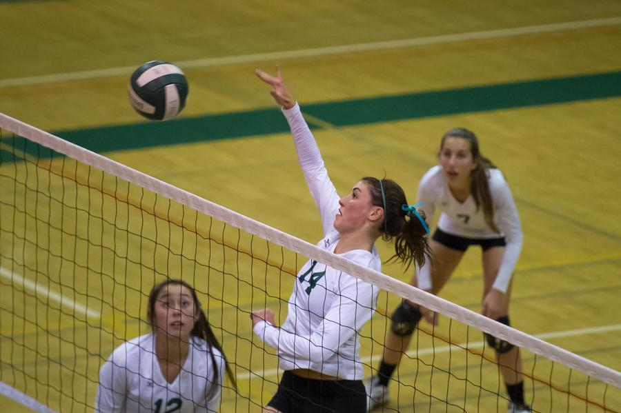Outside hitter Becca Raffel ('14) sends a ball over the net during Paly's straight set victory over the Sequoia Cherokees in the quarterfinals of CCS. Raffel had 16 digs, 15 kills and only one error, earning her MaxPrep