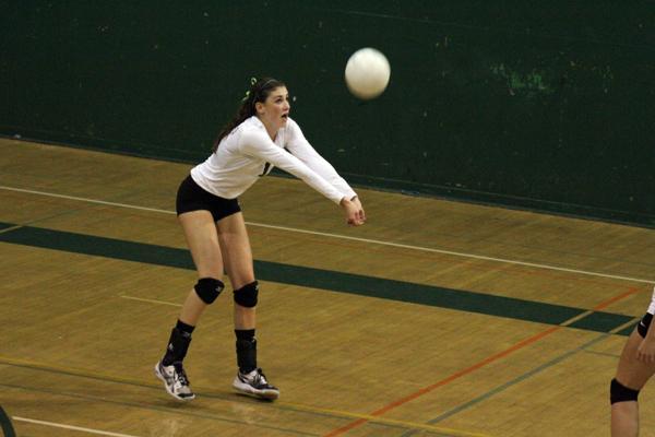 Becca Raffel ('14) returns the ball.  Raffel had 10 kills on the night.