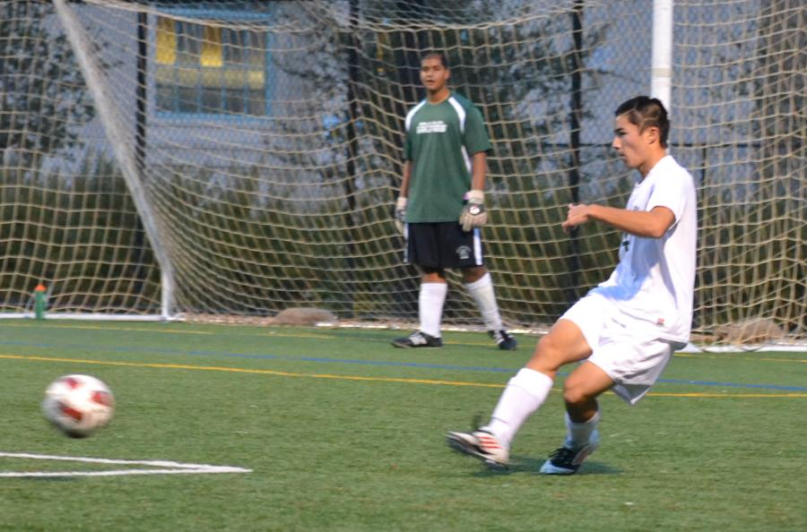 Captain Kirby Gee ('13) clears a ball during Paly's loss to Mountain View.
