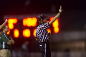 Local Palo Alto referees gives a call in a Paly home football home game.