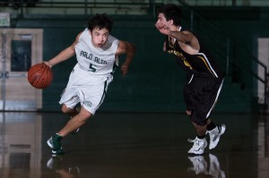 Aldis Petriceks ('13) flies by a Mountain View defender. Petriceks and the Paly boys' basketball team defeated the Spartans 41-30 on Quad Night.